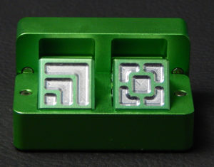 Custom dice box - machined and color anodized aluminium, small green box full of dice