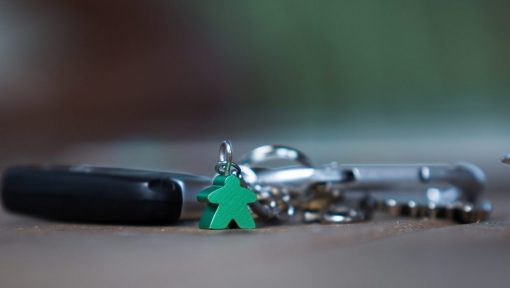 Green meeple key chain made from anodized aluminium