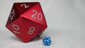 The Tablebreaker, a giant d20 next to a standard size d20